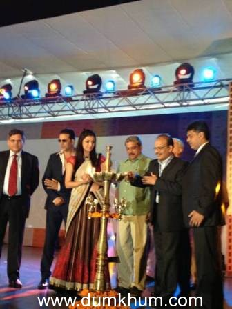 Kajal Aggarwal lights the lamp at the 43rd International Film Festival of India