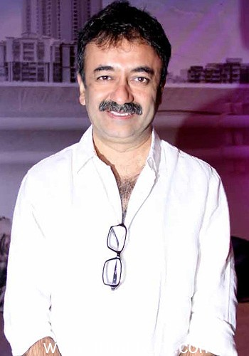 Rajkumar Hirani celebrates R Madhavan's success.
