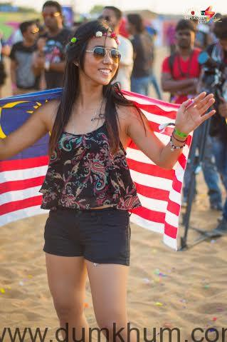A festival visitor basking under the sun ... ing the music at Vh1 Supersonic 2015