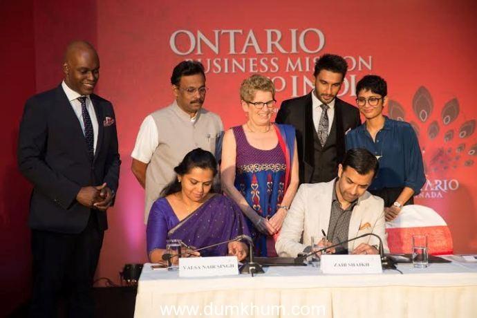(Front, L-R) Valsa Nair Singh and Zaib Shaikh sign MoU (Back, L-R) Cameron Bailey, Minister Vinod Tawde, Premier Kathleen Wynne, Ranveer Singh, Kiran Rao.