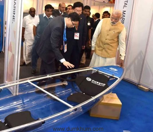 The Prime Minister, Shri Narendra Modi going around an exhibition at the Maritime India Summit, in Mumbai on April 14, 2016. The Union Minister for Road Transport & Highways and Shipping, Shri Nitin Gadkari, the Minister of State for Road Transport & Highways and Shipping, Shri P. Radhakrishnan the Secretary, Ministry of Shipping, Shri Rajive Kumar are also seen.