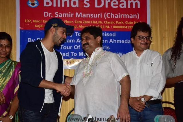 Varun Dhavan congratulating Dr Sa ... d Dream with Asit Kumarr Mod