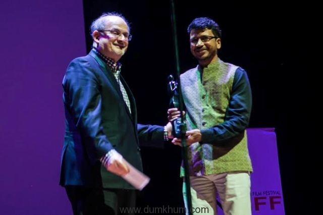 Salman Rushdie presenting the award ... won Best Director for the film.