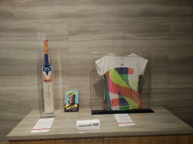Sania Mirza's jersey and Chris Gayle's signed bat & book