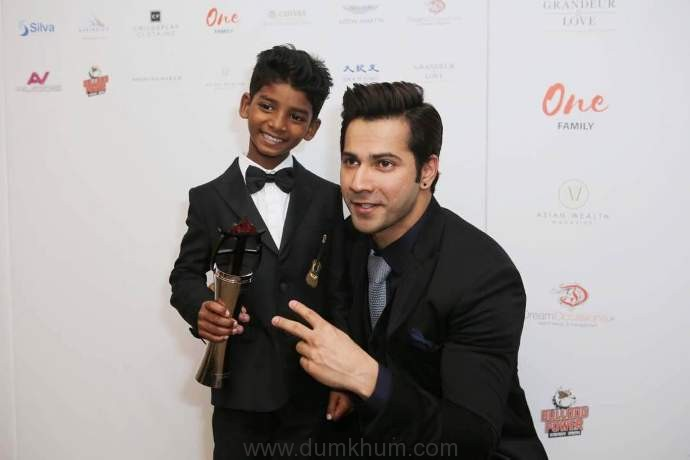Varun Dhawan presents LIon actor Sunny Pawar with Rising Star of the Year award at the Asian Awards in London...