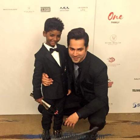 Varun Dhawan presents LIon actor Sunny Pawar with Rising Star of the Year award at the Asian Awards in London..
