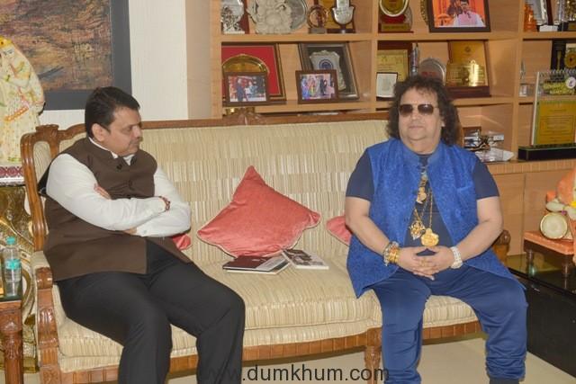 2. Bappi Lahiri with Devendra Fadnavis (Chief Minister of Maharashtra) unveiling Jai Ganesh Single by Bappi Lahiri