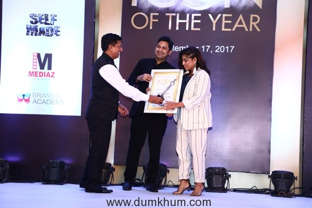 RJ Malishka being presented with icon of the year award