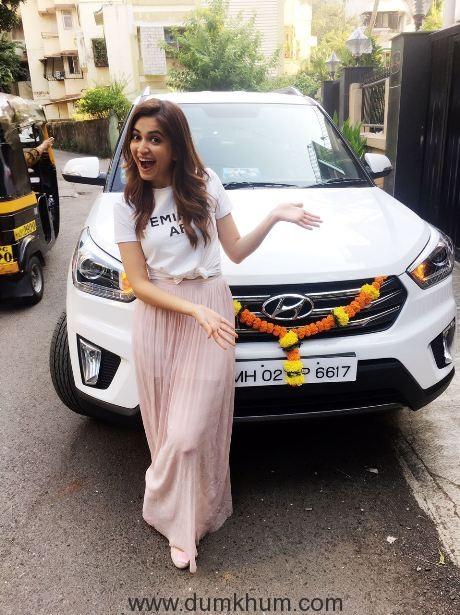 Krti Kharbanda gifts herself a swanky car!