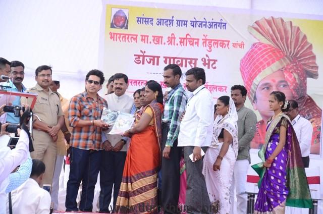 Photo 14 - Shri Sachin Tendulkar felicitates local villagers at an event at adopted village Donja