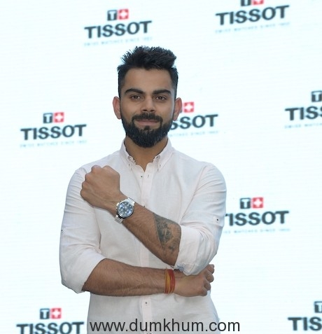 Brand Ambassador Virat Kohli posing with his Tissot watch at the Opening of the New Tissot Boutique at Palladium Mall