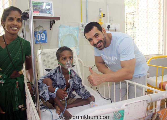 Actor John abraham with the patient at Bai Jerbai Wadia hospital for Children