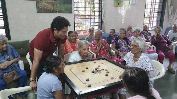 SRT playing Carrom with the ladies at St. Anthony's