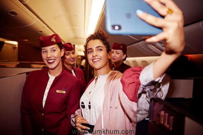 Sanya Malhotra clicks a selfie with Qatar Airways crew