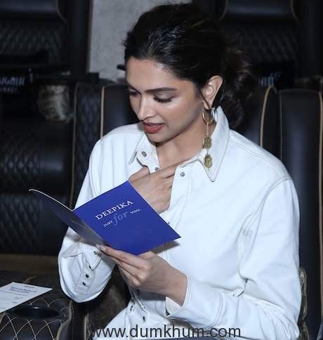 5. Deepika Padukone admiring the specially curated menu